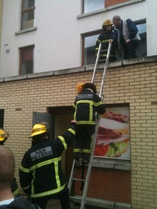 Fire fighters attending to a small fire in Shanowen Square